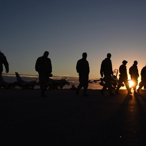 Soldiers and planes at sunset