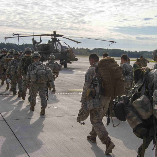 Service Members boarding a helicopter