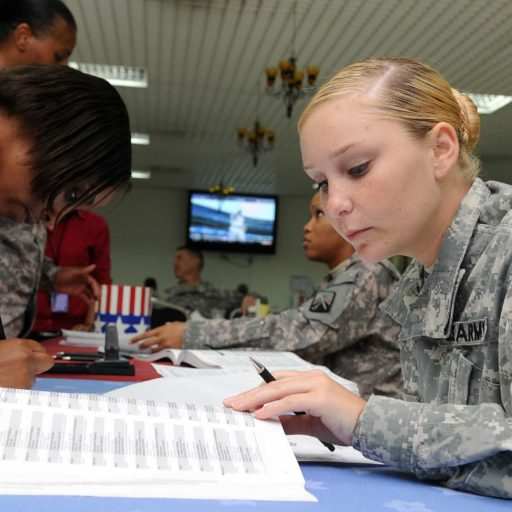 Service member reading a notebook of information