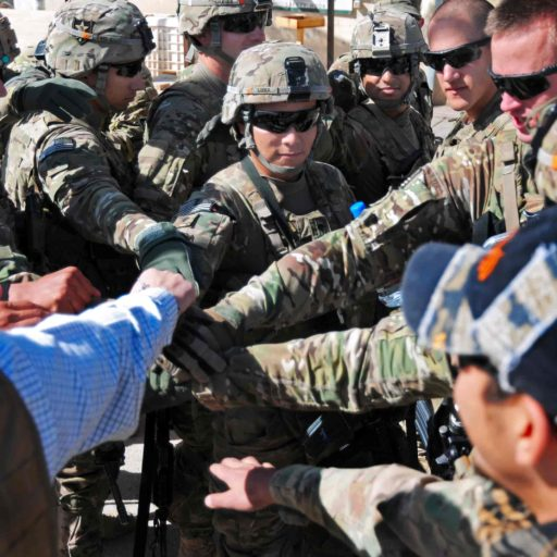 Group of service members coming together in unity