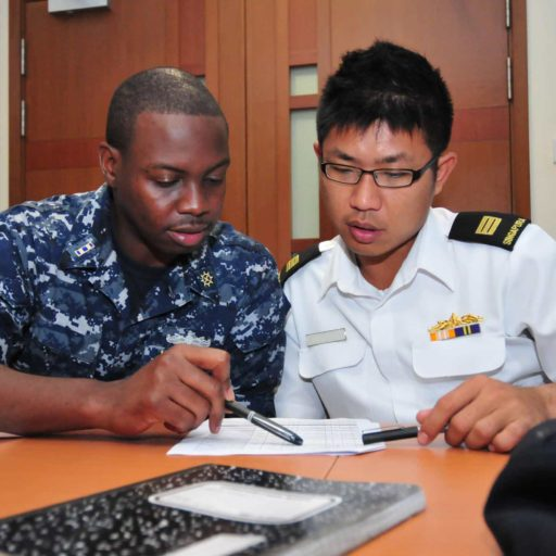One service member tutoring another