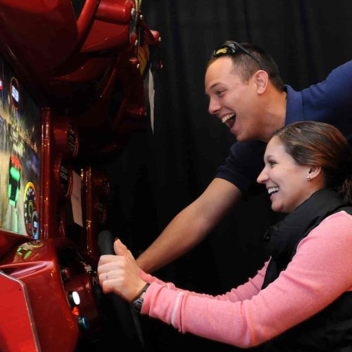 Family enjoying an arcade game